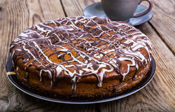 Sponge cake with icing of white and dark chocolate Stock Images