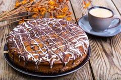 Sponge cake with icing of white and dark chocolate Stock Photos