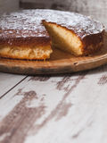 Sponge cake of lemon over wooden background Royalty Free Stock Photo