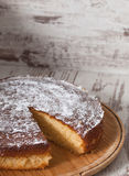 Sponge cake of lemon over wooden background Royalty Free Stock Images