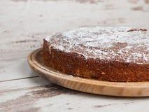 Sponge cake of lemon over wooden background Royalty Free Stock Photography