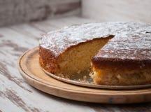 Sponge cake of lemon over wooden background Stock Image