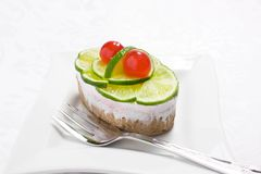 Sponge cake with lime and cherry Royalty Free Stock Images
