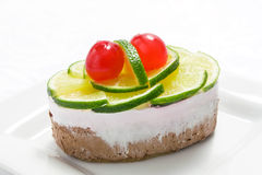 Sponge cake with lime and sweet cherry Stock Image