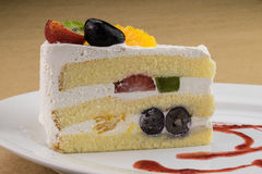 Sponge cake with mix fruit and whipped cream. Sponge cake with mix four fruit and whipped cream Stock Photo
