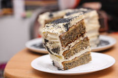 sponge cake with poppy seeds layered with cream with a cut out p Stock Photos