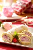 Sponge cake roll with raspberry cream Stock Image