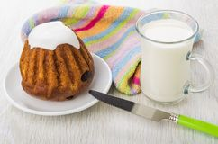 Sponge cake with rum-flavored, milk, napkin and knife Royalty Free Stock Images