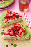 Sponge cake with strawberries and kiwi in shape of watermelon Stock Photography