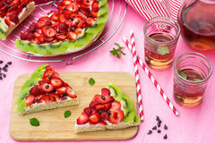 Sponge cake with strawberries and kiwi in shape of watermelon Stock Image