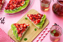 Sponge cake with strawberries and kiwi in shape of watermelon Stock Images