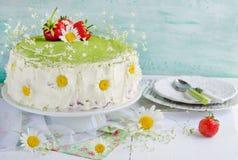 Sponge cake with strawberries and tea Match Stock Photo