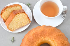 Sponge cake. Tea break: sponge cake and a cup of tea Royalty Free Stock Images