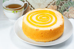 Sponge cake with tea cup Royalty Free Stock Photos