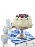 Sponge cake with whipped cream and fresh berries. Sponge cake with whipped cream decorated with fresh strawberries and blueberries stock images