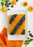 Sponge cake with yogurt mousse, apricots Stock Image