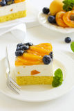 Sponge cake with yogurt mousse, apricots Royalty Free Stock Images