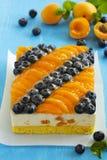 Sponge cake with yogurt mousse, apricots Royalty Free Stock Photography