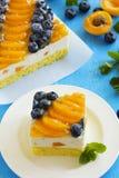 Sponge cake with yogurt mousse, apricots Stock Images