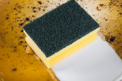 Sponge in clean a frying pan Royalty Free Stock Photo
