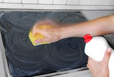 Sponge cleaning. Hand with a sponge cleaning surface in kitchen stock images