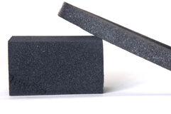 Sponge for cleaning of black footwear Stock Images