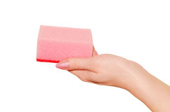 Sponge for cleaning in hand. Sponge for cleaning in hand, isolated on white background Royalty Free Stock Photo
