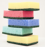 Sponge collection. On top of each other on off white background Stock Photos