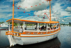 Sponge Diver Boat. With tourists in Tarpon Springs, Florida on cloudy day and colorful boat Stock Photos