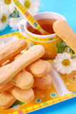 Sponge fingers and tea for child Royalty Free Stock Photo