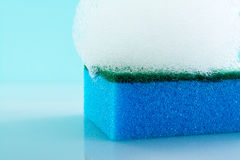 Sponge, foam, bubbles, close-up, macro, texture, light blue background Royalty Free Stock Photography