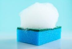 Sponge, foam, bubbles, close-up, macro, texture, light blue background Royalty Free Stock Image