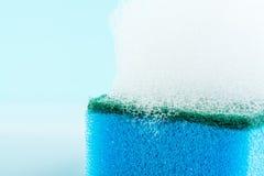Sponge, foam, bubbles, close-up, macro, texture, light blue background Stock Photography