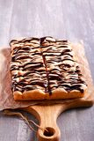 Sponge fruit cake with chocolate drizzle Stock Photos