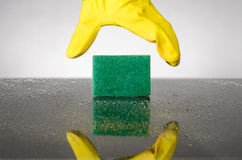 Sponge and glove Royalty Free Stock Image