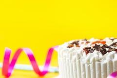 Sponge layer birthday cake with whipped cream frosting milk chocolate star sprinkles strawberry jam. Blue drinking straws stock photos