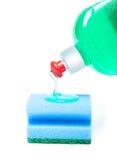 Sponge with liquid. Blue sponge with dishwashing liquid Stock Image