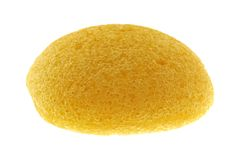 Sponge made of vegetable fiber, Konjac. A round yellow natural facial Sponge made of vegetable fiber, Konjac, isolated on white royalty free stock images
