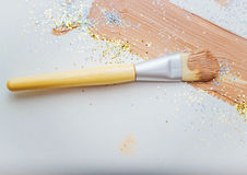 Sponge for make-up with foundation cream. Smears of foundation, sponge for professional make-up Royalty Free Stock Image