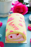 Sponge roll with cream rose Stock Images