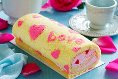Sponge roll with cream rose Stock Photography
