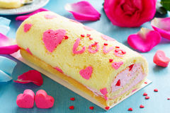 Sponge roll with cream rose Royalty Free Stock Photo