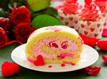 Sponge roll with cream rose Royalty Free Stock Photos