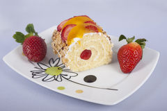 Sponge roll with fruits Stock Photography