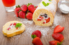 Sponge roll with strawberries and blueberries Stock Photos