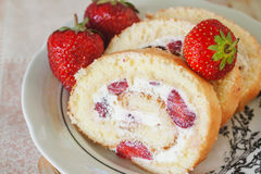 Sponge roulades with cream and fresh strawberries, close-up.  Stock Photo