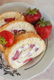 Sponge roulades with cream and fresh strawberries, close-up.  Stock Images