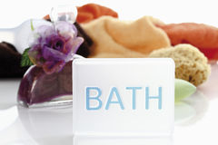 Sponge, soap and bath oil against white background Royalty Free Stock Images