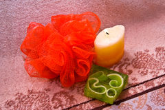 Sponge, soap and candle Stock Photography