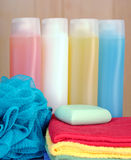 Sponge, soap, shampoo and towels Royalty Free Stock Photos